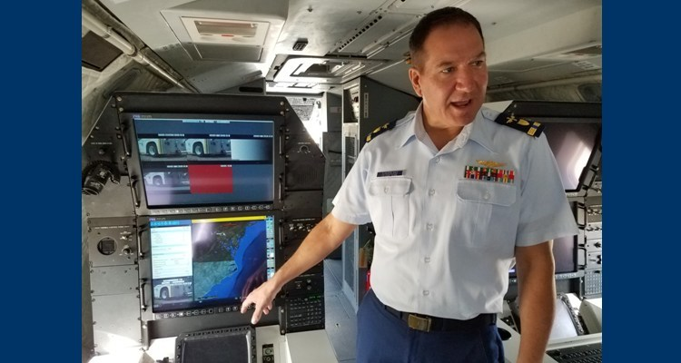 Chief Warrant Officer Robert Sunderland, technical lead for Minotaur Mission system integration, demonstrates data fusion and graphics processing capabilities on the Minotaur mission system prototype HC-144B Ocean Sentry medium range surveillance aircraft April 13, 2017. U.S. Coast Guard photo by Loretta Haring
