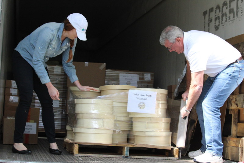 Pictured: WMMB's Social Media Specialist Lizzy Schultz and Director of Retail Programs Kirk Scott help pack the delivery truck for Houston.