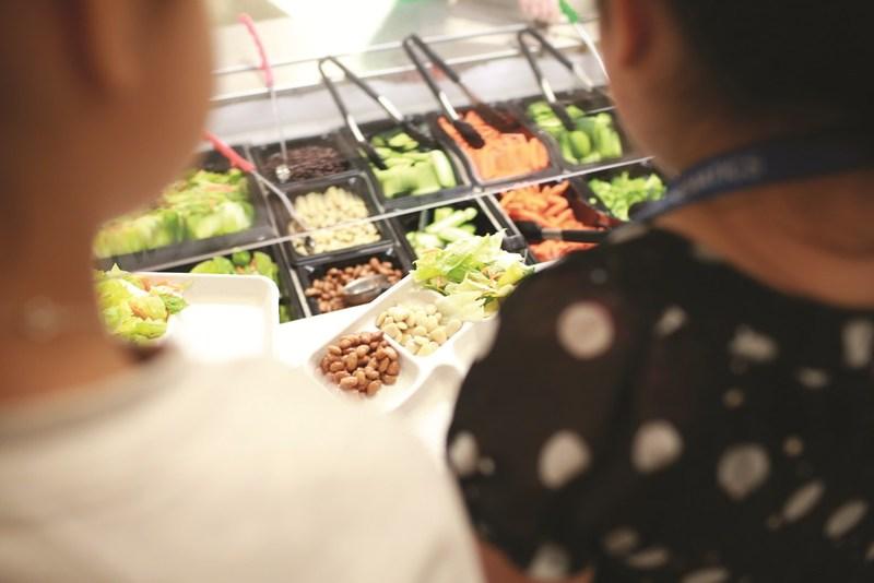 Children enjoying a healthy lunch.