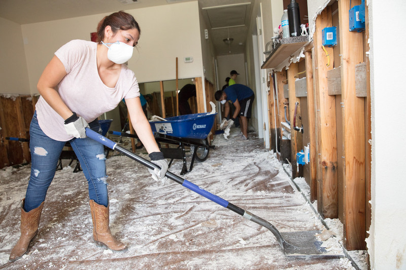 "Houston Habitat for Humanity homeowner Rosalinda helps clean out homes flooded by Hurricane Harvey in northeast Houston. ""I'm devastated, now everything is gone. I'm just glad we are OK,"" she said."