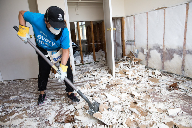 Habitat for Humanity volunteer Vira Griffin helps clean out homes flooded by Hurricane Harvey in northeast Houston in preparation for repairs.