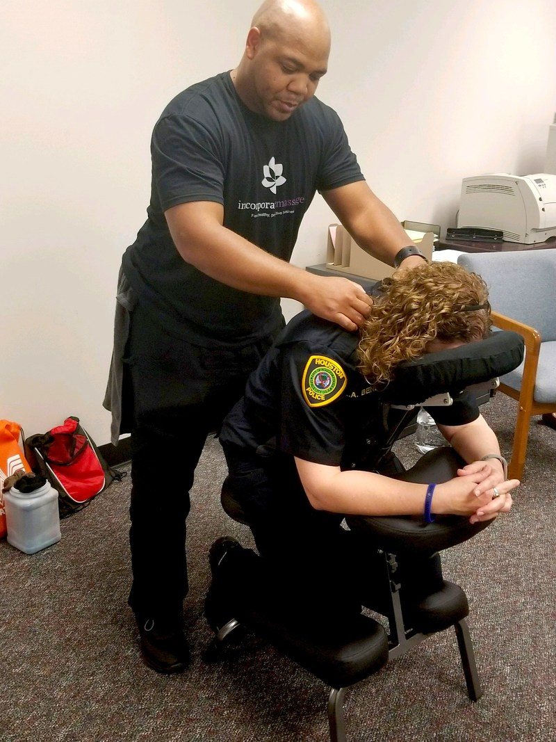 Incorporate Massage provides free chair massages to the Houston Police Department at the Hurricane Harvey Control Center in Houston, Texas.