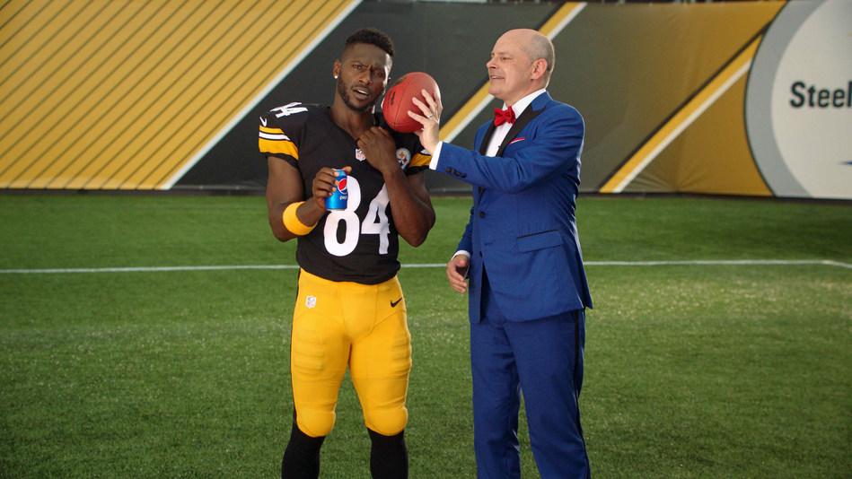 """Pittsburgh Steelers Wide Receiver Antonio Brown and actor Rob Corddry celebrate the beginning of the 2017 NFL season in the new Pepsi NFL campaign, """"The Fun Doesn't End Zone."""""""