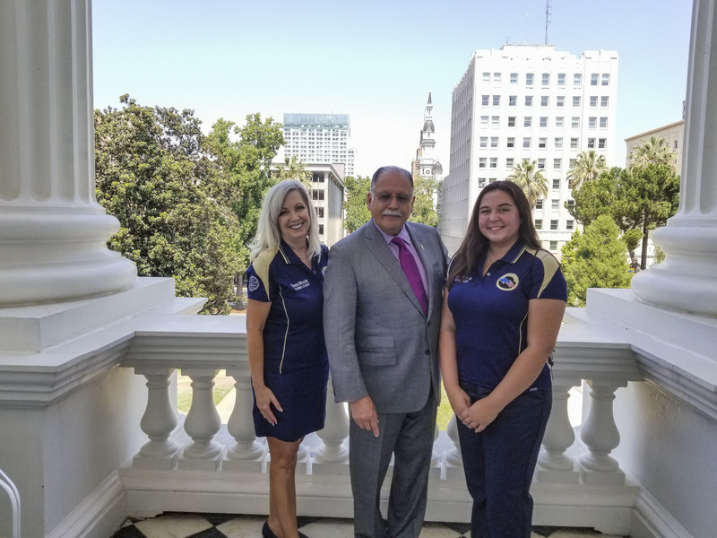 Jose Medina, Chair of Higher Education Committee, California & Assemblymember for 61st Assembly District, (L) Donna Woods, (R) Kassandra Morin