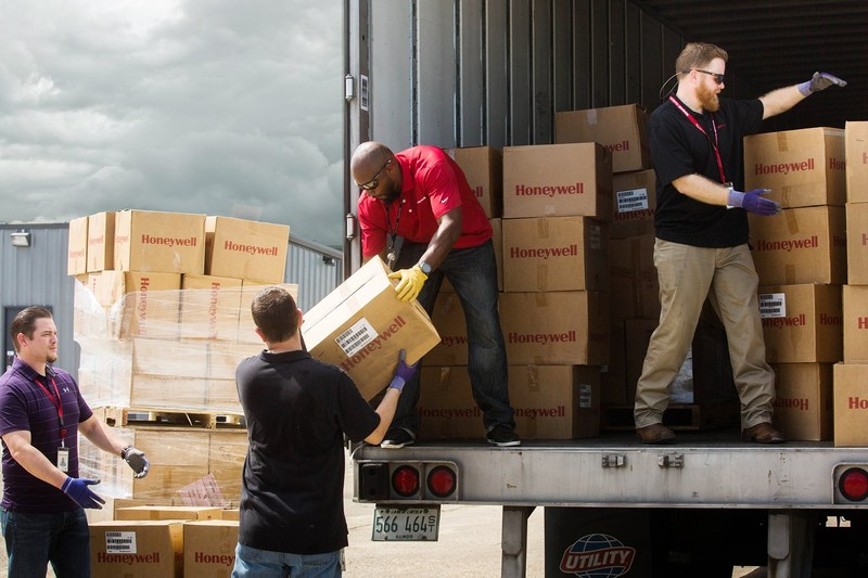 Honeywell employees unload safety equipment for immediate delivery to first responders and emergency personnel to support humanitarian relief efforts in Houston after Hurricane Harvey.