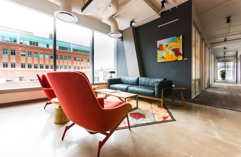 All Serendipity Labs workplaces are designed to brand standards that include furniture selection and an emphasis on of ambient light.