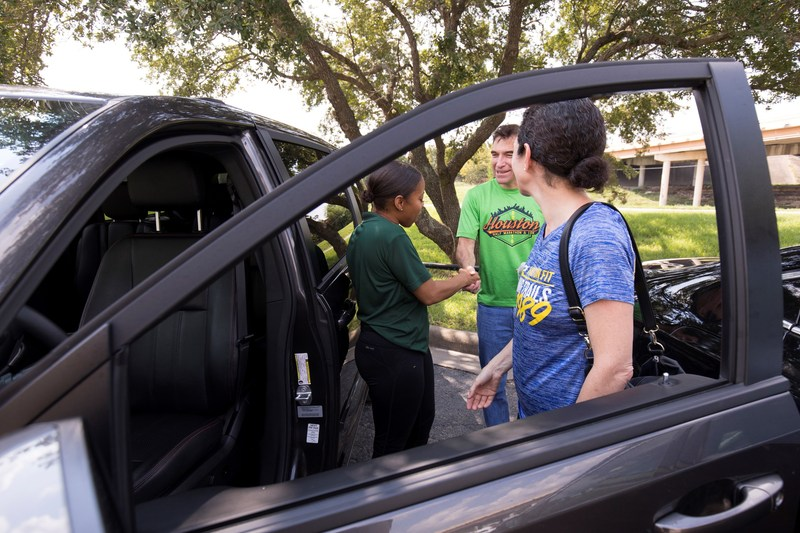 Sept. 2, 2017 – An Enterprise Rent-A-Car employee helps a local customer with a rental vehicle in Houston.