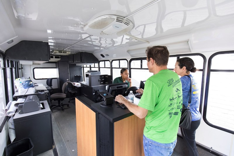 Sept. 2, 2017 – An Enterprise Rent-A-Car employee serves customers in the brand's Mobile Emergency Response Vehicle, a portable, state-of-the-art branch office that was deployed to 4665 N Braeswood Blvd. in Houston to support relief efforts.