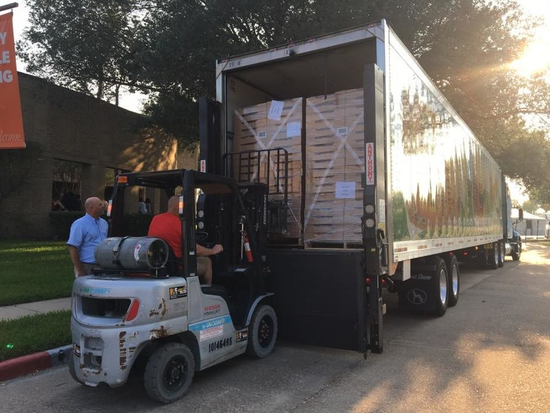Brian Ramer, director of MFPS Transport, watches as the first pallet of bread and rolls is taken off the truck by a volunteer at Houston's First Baptist Church.  Hundreds of volunteers helped distribute the Martin's bread and rolls to people who were affected by Hurricane Harvey.
