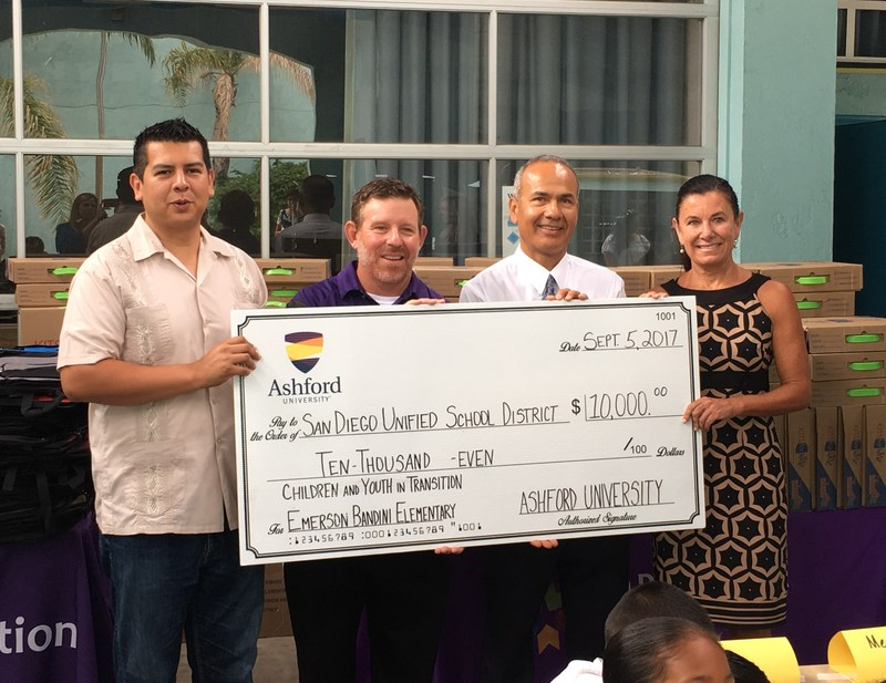 Presenting Ashford University's $10,000 check to San Diego Unified School District's Children and Youth in Transition Program are (from left to right): San Diego City Councilman David Alvarez, Ashford University College of Education Executive Dean Dr. Tony Farrell, Emerson/Bandini Principal Juan Romo, and San Diego Unified School District Superintendent Mitzi Merino.