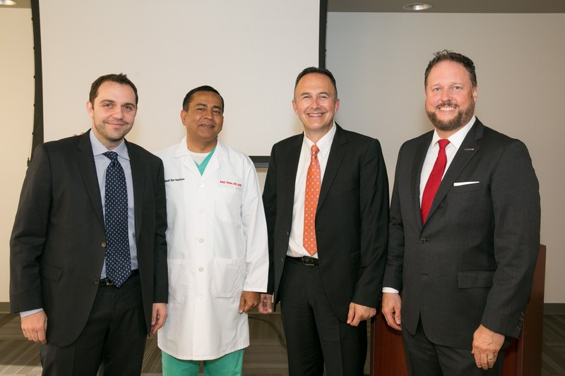Giuliani Scarcelli along with USC Roski Eye Institute's director and dean of the Keck School of Medicine of USC, Dr. Rohit Varma, and USC Roski Eye Institute's Farha Hafezi, J. Bradley Randleman celebrate their breakthrough research on corneal cross-linking (CXL) and LASIK flap creation