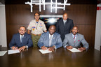 Shown in photo (left to right) SEATED: Arthur R. Thomas, Esq., 31st International President Phi Beta Sigma Fraternity, Inc.; Jonathan A. Mason, Sr., 34th International President Phi Beta Sigma Fraternity, Inc.; Lee Shaw, Jr., Director of National Alliances, Boy Scouts of America;  STANDING (left to right): William B. Covington, Assistant Council Commissioner, Northeast Illinois Council Boy Scouts of America and Keith Walton, Associate National Director Boy Scouts of America
