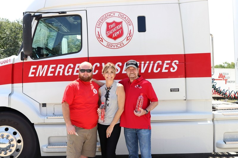 Max Roush, volunteer driver for The Salvation Army; Gena and Chuck Norris, owners of CForce Bottling Company
