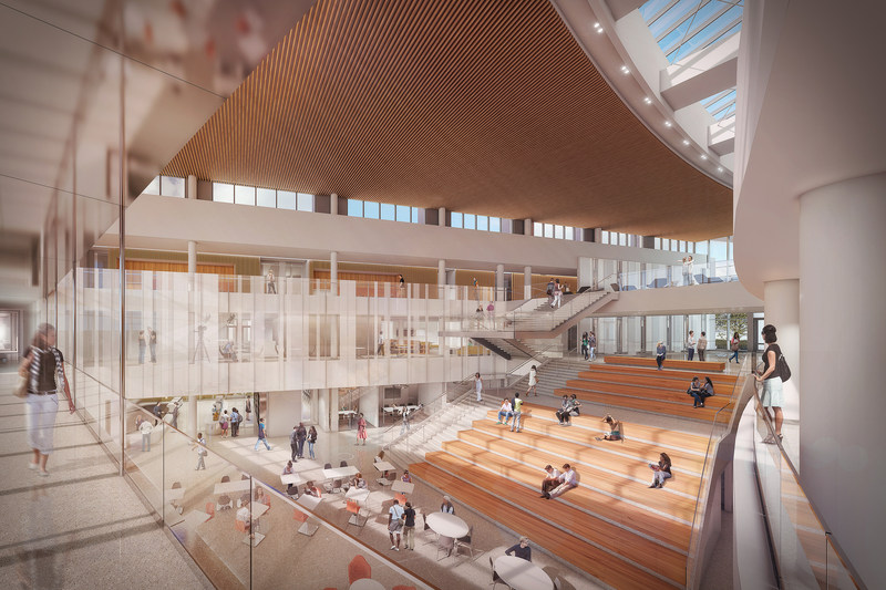 The daylit central atrium is the new focus of the Broad College community, facilitating events, informal interactions, and providing a café for campus-wide use. Broad College of Business, Michigan State University. Design by LMN Architects.