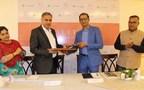 Mr. Dharampal of Olitia Foods exchanging MoU with Mr. Gurdeep of Greanleaf, UK (PRNewsfoto/Olitia Foods Pvt. Ltd.)