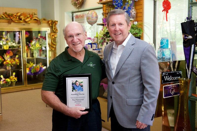 "Teleflora's Jack Howard presents the third annual Tom Butler ""Floral Retailer of the Year"" Award to Paul Raimondi, owner of Raimondi's Florist in his hometown of Baltimore, Maryland."