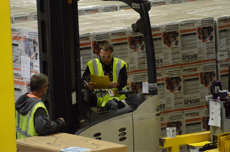 Workers at a Generac Power systems distribution center prepare shipments of generators bound for Florida and the Southeast in the company's response to Hurricane Irma.
