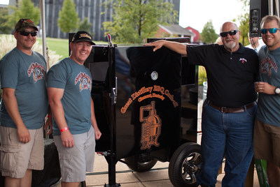 """""""The Smoking Barrel Boys"""" of The Independent Stave Company pose with seventh generation Jim Beam Master Distiller Fred Noe after winning """"The Great Distillery BBQ Cook-off"""" at the Jim Beam American Stillhouse in Clermont, Ky. on Saturday, Sept. 9, 2017. The team was named grand champion, beating eight others in the first annual barbecue cook-off between some of Kentucky's finest distilleries and cooperages."""