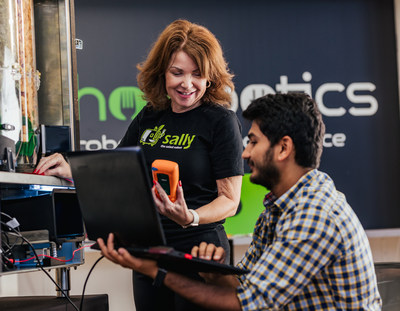 Chowbotics' Vice President of Engineering Dorothy Cudia works with Mechanical Engineer Sanath Bhat on Sally the Salad Robot.