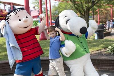 Snoopy, Linus and a fan ham it up at Cedar Fair's Kings Island near Cincinnati, Ohio.