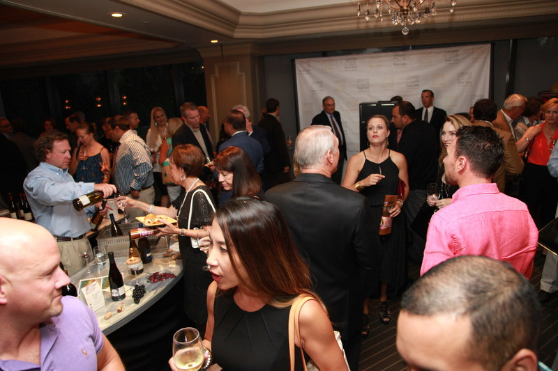 "Courtesy of Center Club, photo by Tony Lattimore - Last year's 10th Annual Charity Classic dubbed ""Hops & Vines"" reached record attendance, and attracted new sponsors for this year party for OC causes, including Working Wardrobes."
