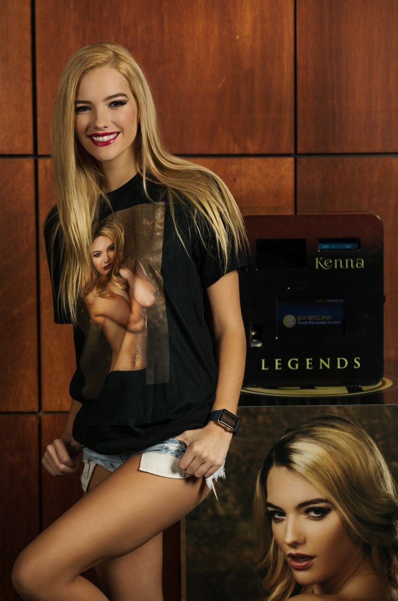 Adult Entertainer Kenna James stands next to a Kenna James-branded Bitcoin ATM at The Legends Room, Las Vegas' world class gentlemen's cabaret re-imagined using blockchain technology.