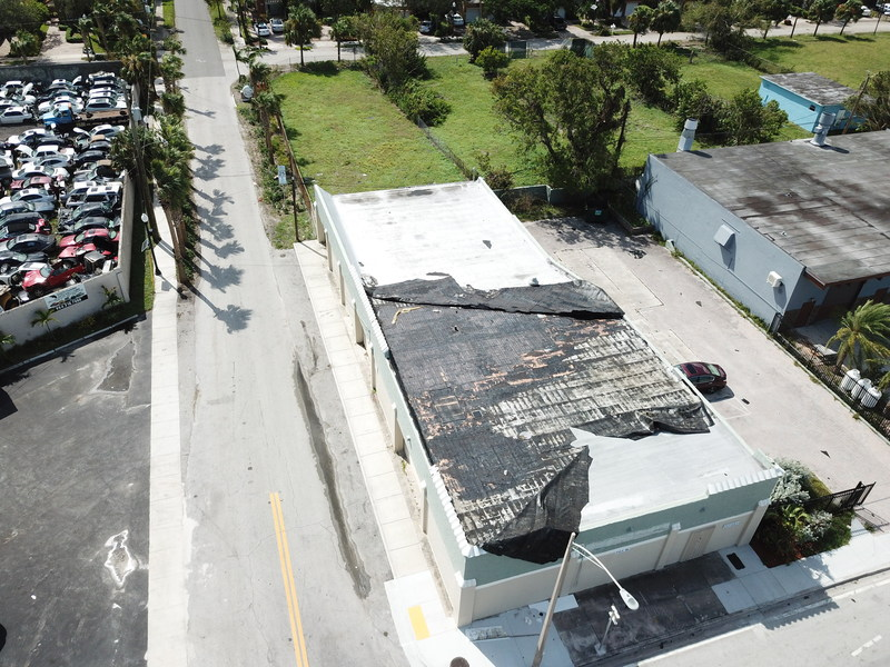 Drone photography shows severe damage to the roof of the .CLUB office building