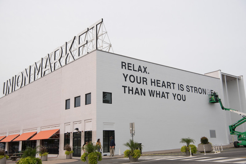 Public art mural, by artist Yoko Ono, installed on the exterior wall of Union Market in collaboration with the Hirshhorn Museum (photo credit: Emma McAlary)