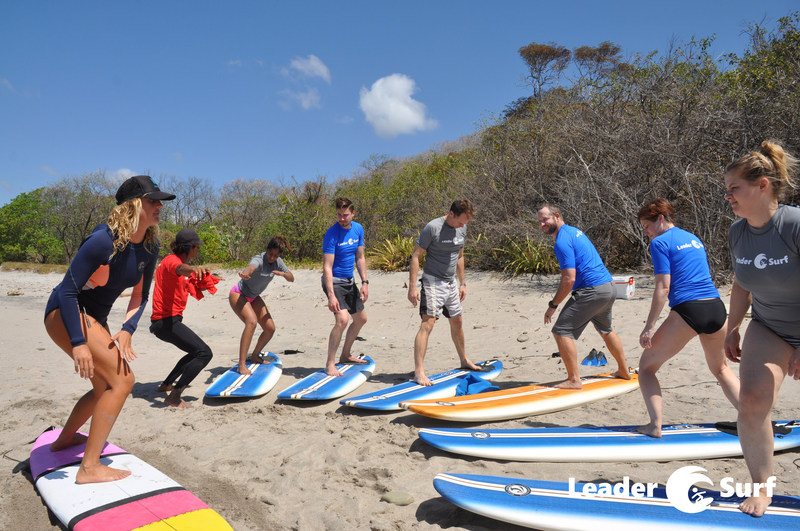 LeaderSurf participants learning the basics of surfing. Pushing outside their comfort zones.