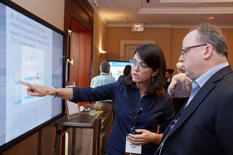 Discussing research during the Rainin Foundation's Innovations Symposium poster sessions. Photo credit: Mitch Tobias