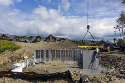 Superior Walls precast concrete foundation systems being positioned in place for new townhouses at the Hermitage Club in Vermont.