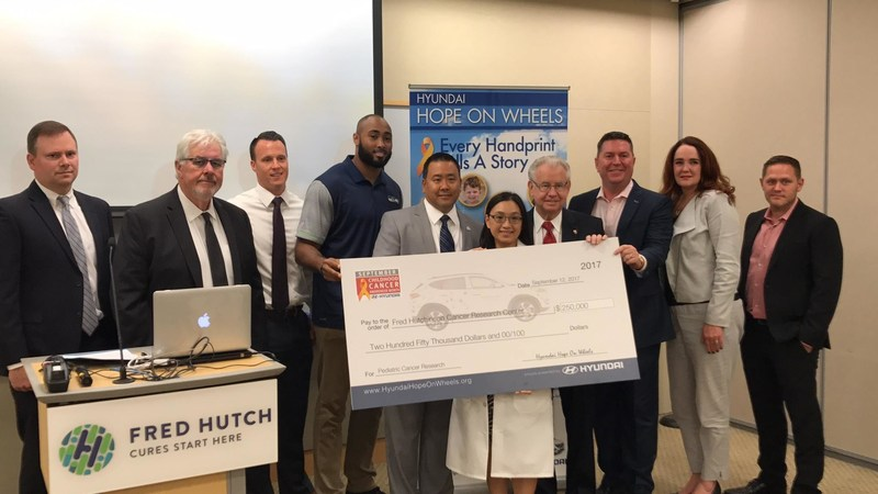 Representatives from Hyundai Hope On Wheels, Hyundai Motor America and local Hyundai dealers pose for a photo with Seattle Seahawks linebacker K.J. Wright (4th from left) and newly-named Hyundai Scholar Dr. Cecilia Yeung (5th from right) of Fred Hutchinson Cancer Research Center during a Hope On Wheels Handprint Ceremony on Tuesday, September 12, 2017. Hyundai Hope On Wheels presented Fred Hutchinson Cancer Research Center with a $250,000 grant to support pediatric cancer research led by Dr. Yeung.