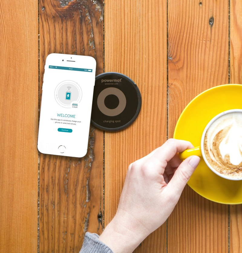 Powermat is excited to announce that consumers will be able to seamlessly charge Apple's newest smartphones on Powermat Charging Spots located around the world. (PRNewsfoto/PR NEWSWIRE EUROPE)