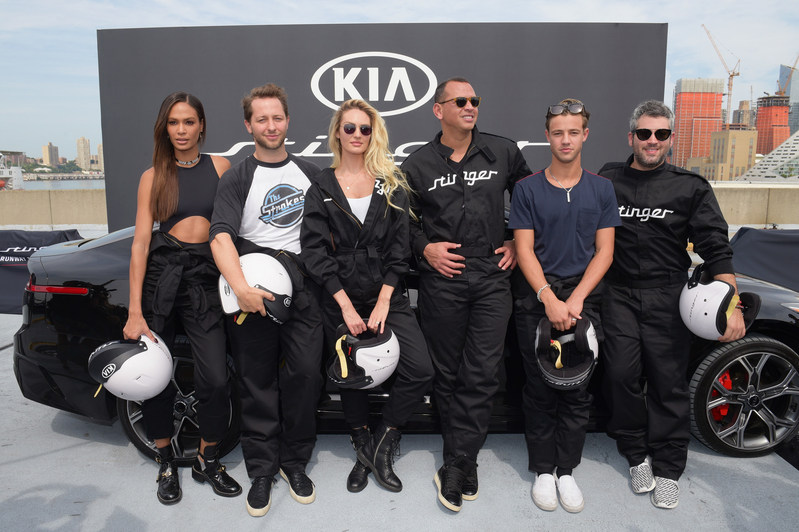 (L-R) Joan Smalls, Derek Blasberg, Candice Swanepoel, Alex Rodriguez, Cameron Dallas, and Brandon Maxwell put the style and performance of the all-new 2018 Kia Stinger to the ultimate test at Pier 92 on September 12, 2017 in New York City.  (Photo by Jason Kempin/Getty Images for Kia Motors)