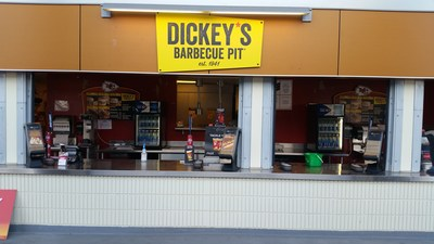 Ryan Wenrich serves Dickey's Texas-style barbecue in Kansas City's Arrowhead Stadium.