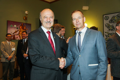 Hon. Reza Moridi, Minister of Research, Innovation and Science, and Dr. Tom Mikkelsen, President & Scientific Director at the Ontario Brain Institute celebrate the strength of strategic partnerships in improving the quality of life for people living with brain disorders at Queen's Park. (CNW Group/Ontario Brain Institute)