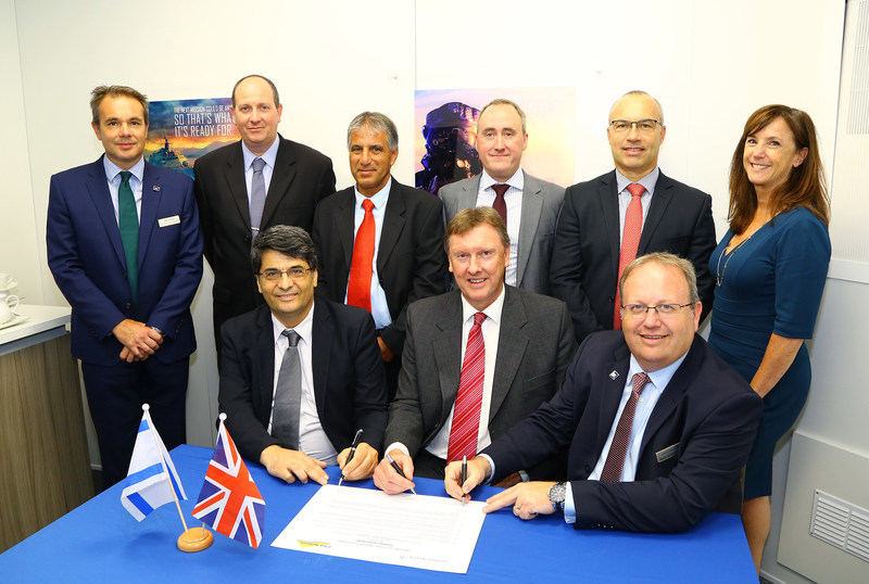 Pictured above in front and signing the teaming agreement (l to r): Edgar Maimon, executive vice president and general manager - EW and SIGINT Elisra Division; Martin Fausset, CEO of Elbit Systems UK and Paul Livingston, vice president of Lockheed Martin UK - Integrated Systems and Paul Livingston, vice president of Lockheed Martin UK - Integrated Systems (PRNewsfoto/Lockheed Martin)