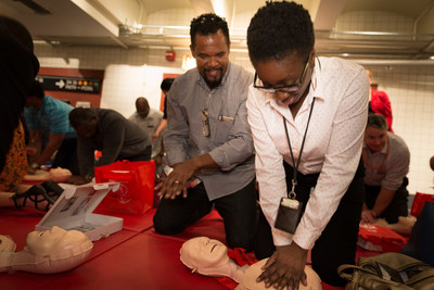 "MTA employee, David Martinez, who performed Hands-Only CPR in Oct. 2016 to save the life of an employee when she suffered a cardiac arrest, helps employee, Shorell Stokes, learn this lifesaving skill at a training supported by Anthem Foundation on Sept. 12, 2017. ""You just never know,"" Stokes said. ""You have co-workers -  you never know when you might need to help them. Plus, I ride the train, I'm on the bus, so you just never know how you you may be able to save somebody's life."""