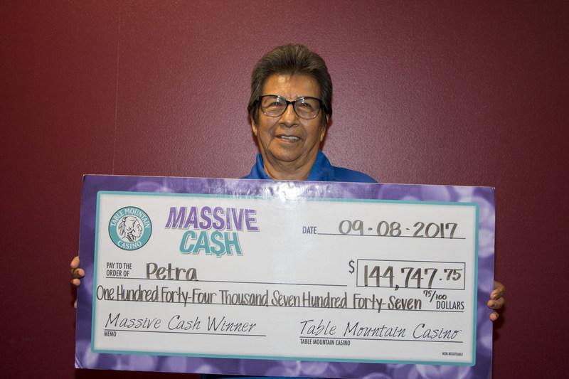 Table Mountain Casino's latest Massive Cash Jackpot winner! (PRNewsfoto/Table Mountain Casino)