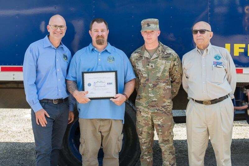John M. Kiely, President of the Kiely Family of Companies, pictured with Steven Allen, U.S. Army Sergeant Alex Conoshenti, and ESGR representative David Farber