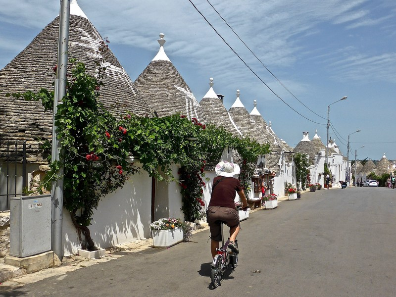 "Stroll - or bike - the streets of Alberobello, Italy and soak in the views of the ""Trullo."" Go off-the-beaten-piazza and visit Alberobello on Globus' New Treasures of Southern Italy vacation. For more information, visit www.globusjourneys.com."