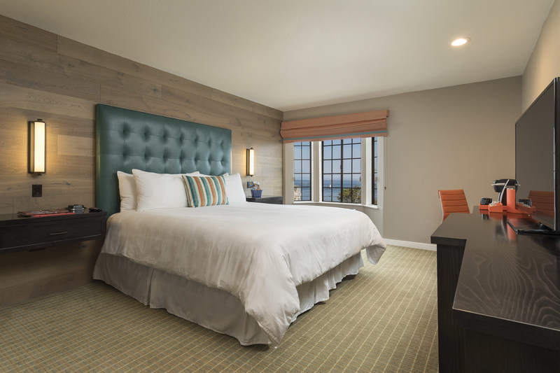 Cannery Row King. Recessed woods. Earthy tones. Creative touches of turquoise and mandarin. Rest and wake up refreshed in this stylish room with one king bed and complimentary WiFi.