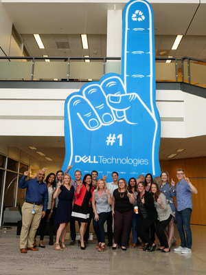 Dell Technologies employees pose with the largest foam finger (made of recyclable materials), a GUINNESS WORLD RECORDS™ achievement, at Dell's headquarters in Round Rock, Texas on Monday, September 11, 2017.