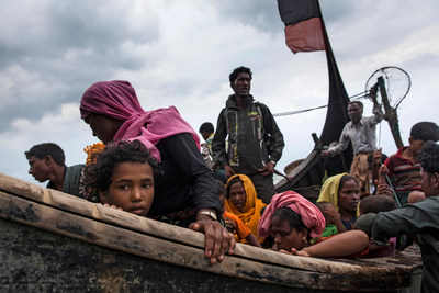 On 7 September 2017, newly arrived Rohingya refugees travel by boat from Myanmar on the Bay of Bengal to Teknaf  ...