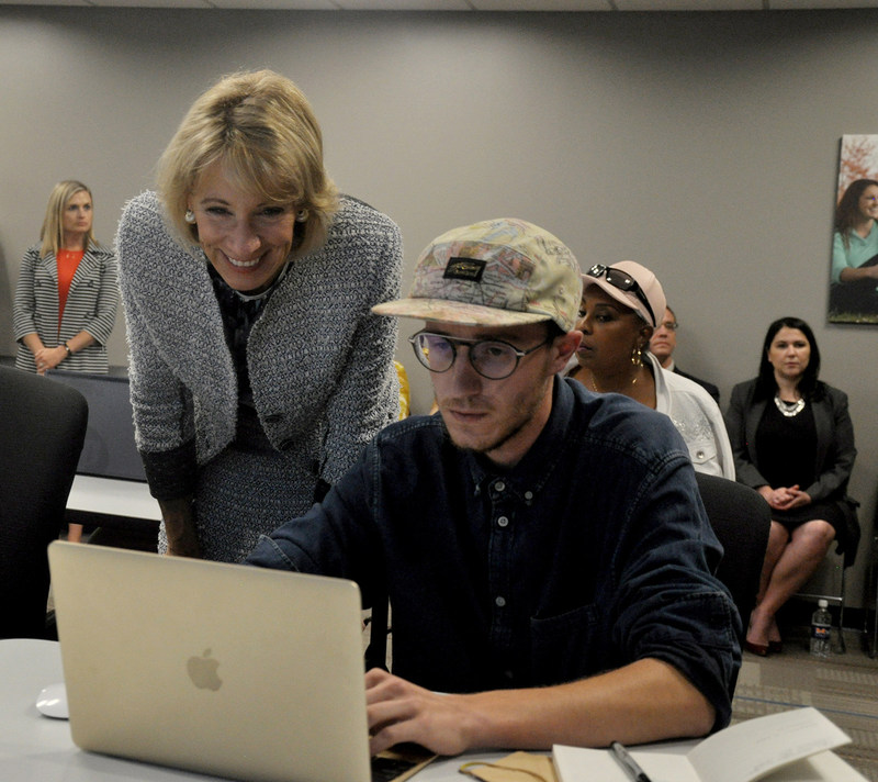 U.S. Secretary of Education Betsy DeVos visits with Midland University Code Academy student Andy Kollath on Wednesday, Sept. 13, during her visit to Midland University's Omaha campus. (Midland University Communications photo)