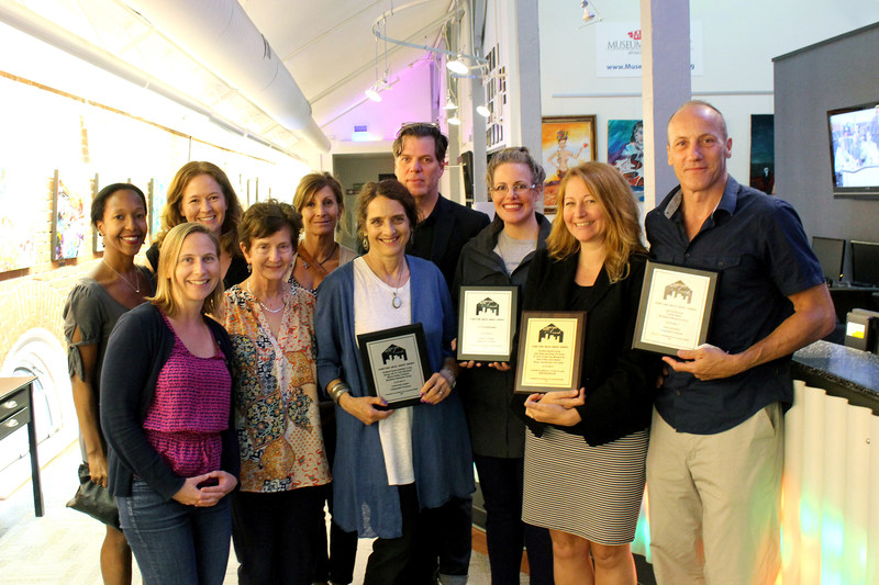 BIG staff, board members, and members who won ACM awards celebrate their achievements together.