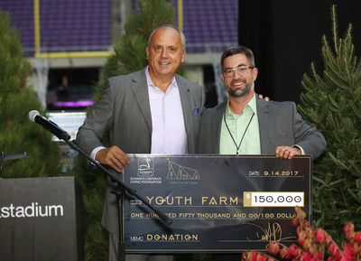 Dimitrios Smyrnios, CEO of Schwan's Company announces a new charitable partnership with Minnesota-based non-profit Youth Farm. Smyrnios presents Gunnar Liden of Youth Farm a $150,000 financial donation from Schwan's Corporate Giving Foundation at U.S. Bank Stadium on Thursday, Sept. 14, 2017, in Minneapolis. (Andy Clayton-King/AP Images for Schwan's Company)