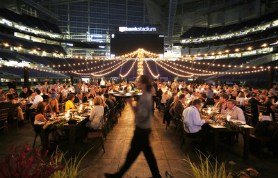 To kick off football season and celebrate its founding partnership with the Minnesota Super Bowl Host Committee, Schwan's Company transformed U.S. Bank Stadium into a 'Feast on the Field' -- a culinary celebration for local business leaders, sports legends, customers, and media on Thursday, Sept. 14, 2017, in Minneapolis. (Andy Clayton-King/AP Images for Schwan's Company)