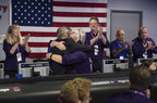 Earl Maize, program manager for NASA's Cassini spacecraft at the agency's Jet Propulsion Lab, and Julie Webster, spacecraft operations team manager for the Cassini mission at Saturn, embrace in an emotional moment for the entire Cassini team after the spacecraft plunged into Saturn, Friday, Sept. 15, 2017. Credit: NASA