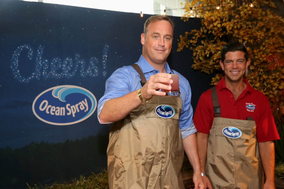 American Ninja Warrior host Matt Iseman toasts 'total victory' with a custom cranberry cocktail and Ocean Spray Farmer-Owner Clinton May at the Kari Feinstein Style Lounge Thursday, Sept. 14 in Los Angeles. (PRNewsfoto/Ocean Spray)